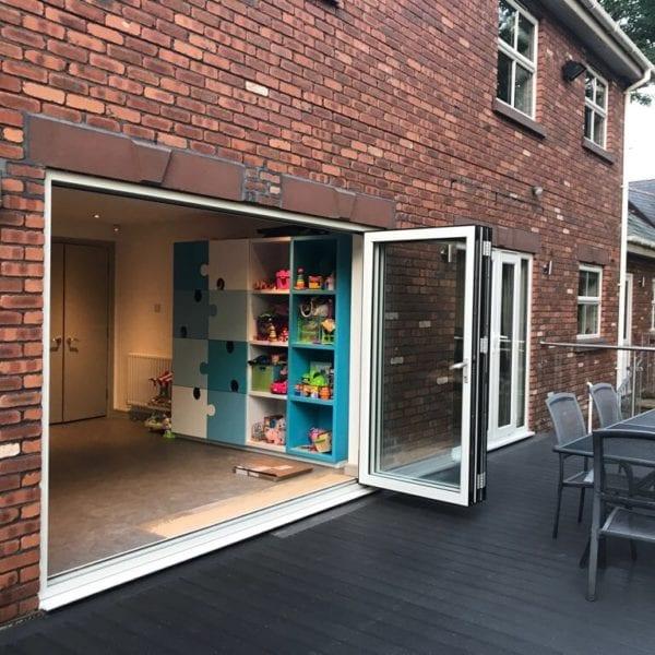 Open bifold doors leading to decking