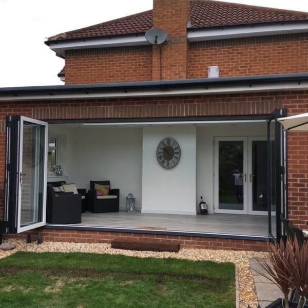 Open bifold doors from living room in Liverpool